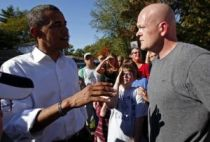 File photo of US Democratic presidential nominee Senator Obama speaking to Joe the Plumber in Ohio