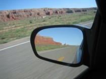 cross-country-road-trip-looking-back-at-some-craggy-red-rocks